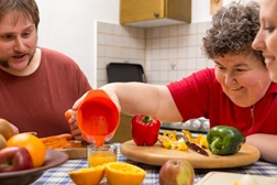 Vulnerable adults preparing food in a kitchen